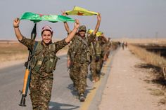 Tell Abyad, Syria Kurdish fighters waving flag after victory in Tell Abyad on June 15, 2015.