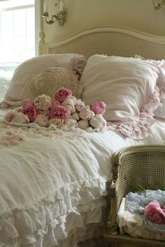 What a luxurious, comforting bedroom with white lace cover and pink roses.
