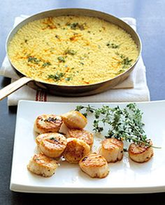 Seared sea scallops are served over Moroccan couscous (instead of rice) infused with the flavors of its cooking liquid: sherry, chicken stock, saffron, thyme, and butter.