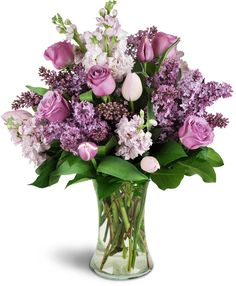 Spring is in the air with this lavish display of royal purple blooms! An abundance of lilacs will bring the fragrance of Spring to your special someone - they'll love it!Lilac, stock, tulips, and roses - all in lush shades of purple and pink - are elegantly arranged in this luxurious bouquet, ready to enjoy today!