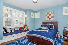 Traditional boys bedroom by Johnson & Associates Interior Design