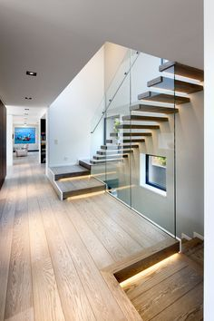 Jestico+Whiles-Smart-Villa-9- led lights in steps, floating steps, glass guard. stunning.