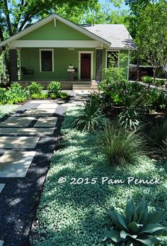 No-lawn front garden; in back, lawn is downsized to a narrow rectangle. Click through for pics. Geometric design creates modern garden for entertaining | Digging
