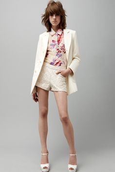 The summer suit: textured shorts with a floral blouse and blazer.