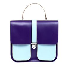 LDN 1574 TOP HANDLE STRUCTURED LEATHER SHOULDER BAG PURPLE/ BLUE The LDN 1574 top handle shoulder bag is hand finished in structured smooth leather. Designed in London and New York it is a bag that will fit everything you need. Made in England. DETAILS Brix + Bailey nickel hardware with a push lock catch. Top carry handle, detachable and adjustable leather strap. Double pocket front. Interior - unlined natural finish. Brix + Bailey embossed logo on rear of bag. WWW.BRIXBAILEY.COM