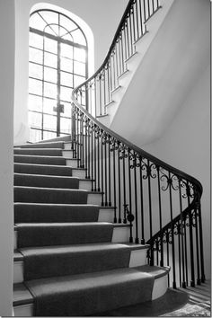 curve of the stairs, landing part way up, French doors, railings