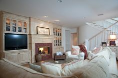 A family room with contemporary style and tons of built in storage.  KellyBaron Design. http://www.kellybaron.com/home