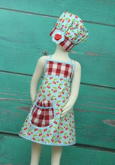 We simplified our design without sacrificing cuteness! This allows for a super reasonable price point for our customers who are purchasing aprons in large quantities for parties. We still have our special ruffled aprons available on our site for the birthday girl. The Blue Cherry