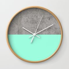 """Sea on Concrete Wall Clock  https://society6.com/product/sea-on-concrete_wall-clock#33=282&34=285  DESCRIPTION Available in natural wood, black or white frames, our 10"""" diameter unique Wall Clocks feature a high-impact plexiglass crystal face and a backside hook for easy hanging. Choose black or white hands to match your wall clock frame and art design choice. Clock sits 1.75"""" deep"""