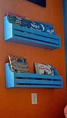 I want to make this!  DIY Furniture Plan from Ana-White.com  Wall book holders keep kids books easy to put away and easy to access. Try them on blank wall spaces, top bunks, or throughout your home to add storage and style without much cost or investment. These shelves can be made for less than $5 each, or free if you have a stock pile of scraps.