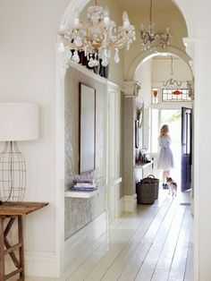 chandeliers - want one like this for the lounge. I adore this hallway & decor.