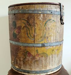 This Pennsylvania Dutch Folk Art decorated barrel with its original surface and worn folk art paint is a timeless treasure. Signs of red, blue, green and mustard paint with Pennsylvania Folk Art motifs around the barrel and worn artistic painted Pennsylvania Dutch dialect and original hinges makes this one special!