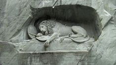 "The Lion Monument (German: Löwendenkmal), or the Lion of Lucerne, is a sculpture in Lucerne, Switzerland, designed by Bertel Thorvaldsen and hewn in 1820–21 by Lukas Ahorn. It commemorates the Swiss Guards who were massacred in 1792 during the French Revolution, when revolutionaries stormed the Tuileries Palace in Paris, France. Mark Twain praised the sculpture of a mortally-wounded lion as ""the most mournful and moving piece of stone in the world."""