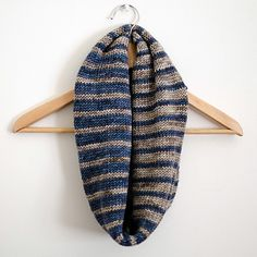Duotone Cowl is a continuous loop created by grafting the ends of a stockinette tube. Two colors are worked in a series of stripes which switch in size halfway around the cowl.