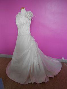 Robe de mariée d'occasion de chez Point Mariage, coloris Ivoire et Champagne
