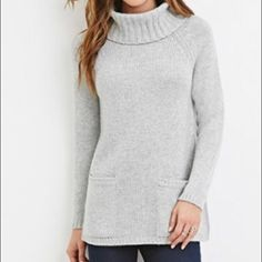 NWT Forever21 Heather Gray Sweater Super cute new light heather gray turtle neck sweater - with front pockets. No trades. Offers welcome. Size med. Medium to heavy in weight Forever 21 Sweaters Cowl & Turtlenecks
