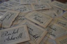 escort cards with old book pages