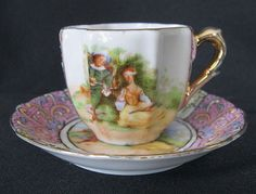 Porcelain Demitasse Child's Cup and Saucer with Victorian Couple and Pink Scroll Panels