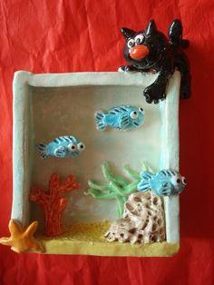 Poterie: chat et aquarium.