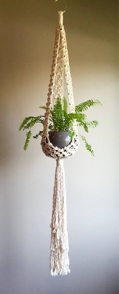 What Everybody Dislikes About Macrame Plant Hanger and Why Hold all the end strands tight with one hand and put your pot in the net to make sure you've got all your knots in the right places, and to observe… Continue Reading → Macrame Art, Macrame Projects, Macrame Knots, Décor Boho, Boho Hippie, Bohemian Style, Macrame Patterns, Hanging Planters, Jute