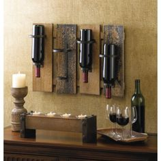 This unique and rustic Wood And Metal Wine Bottle Display Wall Mount Rack Decor will attract a lot of attention, and not just because it holds your favorite wine! Four wooden slats mount to your wall and feature simple metal wine holders that allow you to place four bottles upside down. A great accessory for your dining room, you'll always have your next bottle of wine within reach!