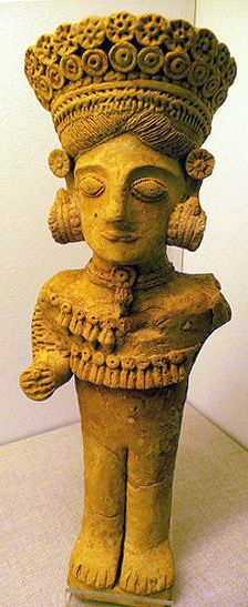 La Dama de Ibiza, widely considered to represent the Carthaginian goddess Tanit.    Another unusual fusion of styles,  with flower-adorned headdress, necklaces, and a spiralled dress  with a Gorgon head near the hem.    Molded terracotta, 3rd century bce,  Puig des Molins.