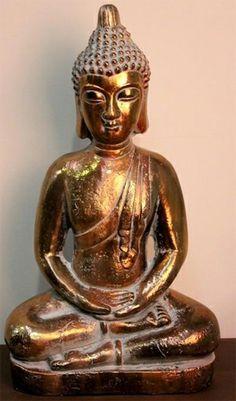 Figura budista dorada