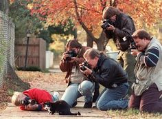 Paparazzi surrounding Socks, Bill Clinton's cat, 1992.