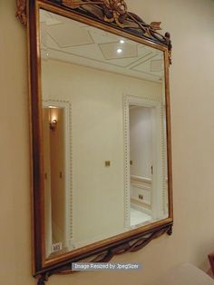 Lot 603 - An Empire style painted and gilt wall mirror 740mm x 1180mm