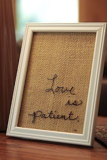 Love is Patient embroidered on burlap in white frame.