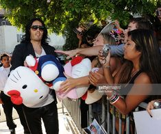 Actor Russell Brand hands out Hello Kitty items to fans outside the Moroccanoil Celebrity Gift Retreat by Backstage Creations at Teen Choice at Gibson Amphitheatre on August 8, 2010 in Universal City, California.