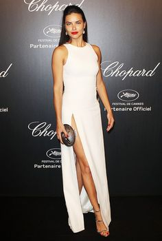Adriana Lima wears a slim-fitting white gown and Giuseppe Zanotti heels at the 2015 Cannes Film Festival