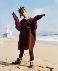 Sizing Up - The thing about the big-sweater, big-shirt look is that it's unisex: It's practically the original borrowed-from-the-boys moment. Actor and rapper Jaden Smith wears a Raf Simons rib-knit sweater ($2,013), shirt ($560), and pants ($686); rafsimons.com. Dr. Martens boots.  In this story: Hair: Jimmy Paul for Bumble and Bumble; Makeup: Aaron de Mey Hair for Zendaya: Kim Kimble; for Jenner: Tokyo Stylez; for the Smiths: Marcia Hamilton for KeraCare Set Design for Zendaya, Bennet...