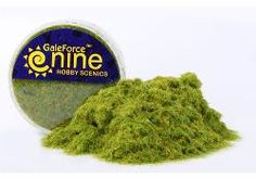 """Brush on a layer of glue, then shake this powdered fake """"grass"""" on it, shake off the excess and voila! Flat mossy-ish looking stuff for cupcakes to sit on! ...I'm gonna buy a tub of the Marsh Blend to play with..."""