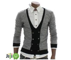 A cardigan is a type of sweater – a knitted garment with an open front, which commonly has buttons. Some models don't have buttons and hang open (by special design, which is considered more modern). Some may be tied as a robe. Usually cardigans are knitted – by hand or with machine technology. Interestingly, this …