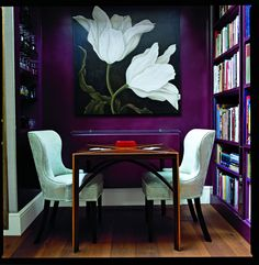 Entryway Idea: An oversized painting contrast against dark grape walls | domino.com