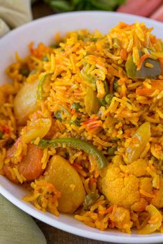 Vegetable Biryani Is A Bold And Flavorful Indian Rice Dish With Bell Peppers, Peas, Carrots And Potatoes In A Spiced Rice Dish Made With Turmeric, Garam Masala And Other Warm Spices. Vegetarian Biryani, Vegetable Biryani Recipe, Vegetarian Recipes Dinner, Veggie Recipes, Indian Food Recipes, Dinner Recipes, Healthy Recipes, Veggie Food, Arabic Recipes