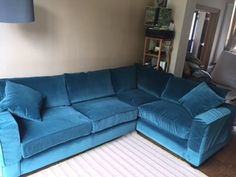 Bespoke right hand facing corner sofa 270 cm x 190 cm in J Brown's Monza (stain repellent finished/washable fabric) colour 14861 teal. We added arm covers for extra child & pet friendliness!