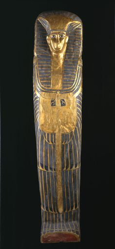 Female coffin: an exceptionally tall coffin with decoration in the rishi-style. The lid has feathered patterning painted in blue with black details on a yellow ground. The owner's face is framed by a striped linen nemes-cloth, a beaded collar with falcon terminals, and a vulture-pectoral. Qurna burial,Egyptian,17th-18th dynasty, 250 years before Tutankhamen was buried.