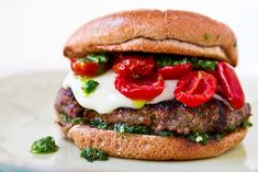 Burgers with Roasted Tomatoes, Pesto, and Mozzarella
