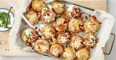 For the ultimate comfort food you can't go past these crispy roast potatoes topped with a cheesy, bacon crumb and served with sour cream and chives.