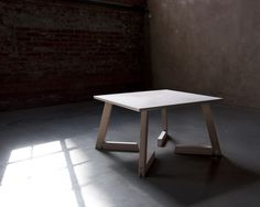 The Bambi table can be used at two different levels; as a coffee table or a small dining table.