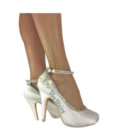 Satin Mini Bow Wedding High Heels in Ivory - pictured with teal lettering, choose your colors Satin Bow Diamond Strappy Bridal Heels for the Wedding with Mrs new last married name or Mrs last name on one shoe and the wedding date on the other shoe These fabulous custom made heels are light ivory in color & the back heel measures approximately 4 inches (11 CM). Your heels are custom hand crafted with our diamond chain beading that traces the elegant lines of satin on this closed toe pump. The…