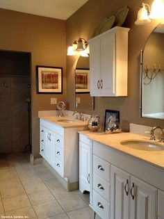 Separate vanities in the master bathroom of the Northwyke Plan 759 - This large master bathroom is a refreshing place to start the day, with plenty of counter and storage space. http://www.dongardner.com/plan_details.aspx?pid=571 #Bathroom #Vanity #Shower