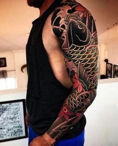 Love this bold black Japanese koi fish tattoo sleeve.