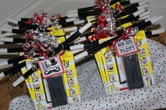 Party favors for each guest:Magnetic Wild Willy game, magic wand and magic coin trick with personalized, themed labels.