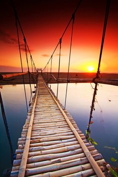 Sunset in Batu Belig Beach, Badung, Bali, Indonesia >>> Think you could take a walk down this bridge? Not sure I could!