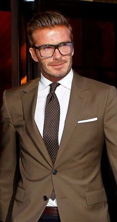 Going with the bookworm/nerd look with those glasses and the polka dotted brown tie. Description from style.astroawani.com. I searched for this on bing.com/images