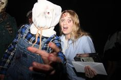 Sackhead Jason reaches out for the camera as Ginny Fields strikes her typical pose!  In her left hand, she holds our awesome winnings; a copy of the new FRIDAY THE 13th COLLECTION BluRay Boxed Set (courtesy of Warner Bros. Home Entertainment) and CASH, baby!  PHOTO COURTESY LEE CHRISTIAN