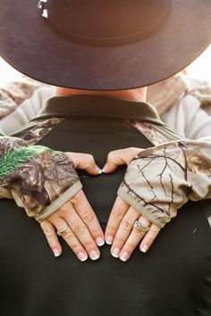 country engagement photo ideas | Country engagement with camo heart!